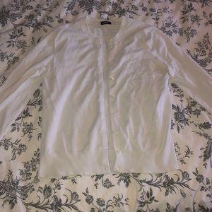 White cardigan.